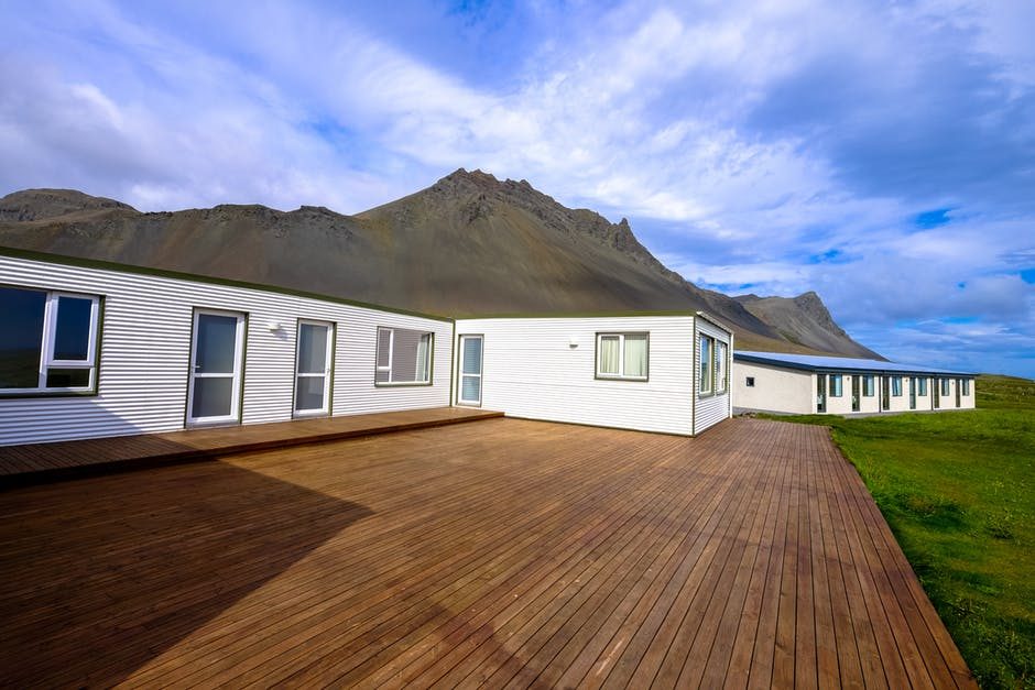 house in front of mountains with composite decking