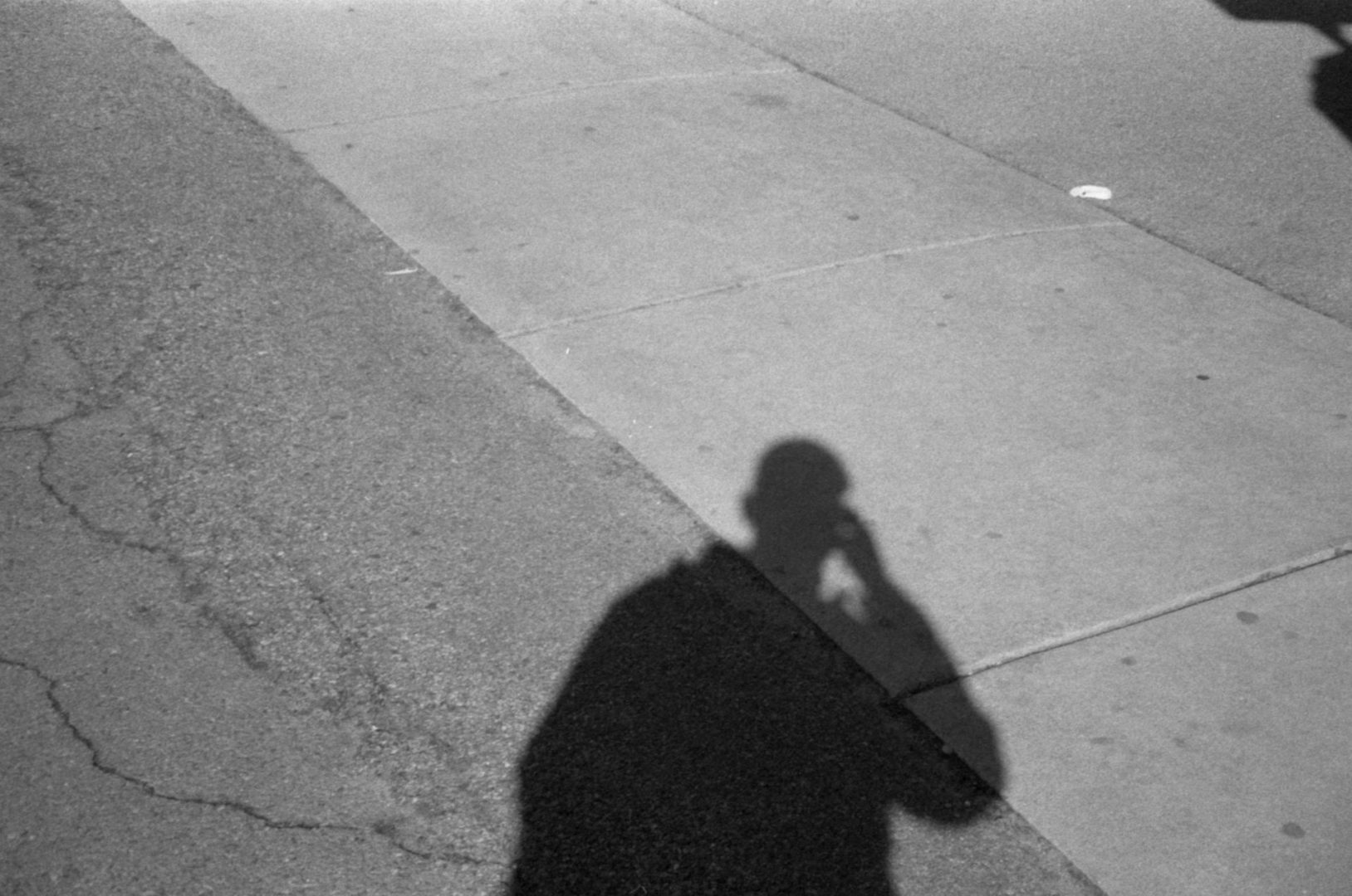 concrete slabs with a person's shadow