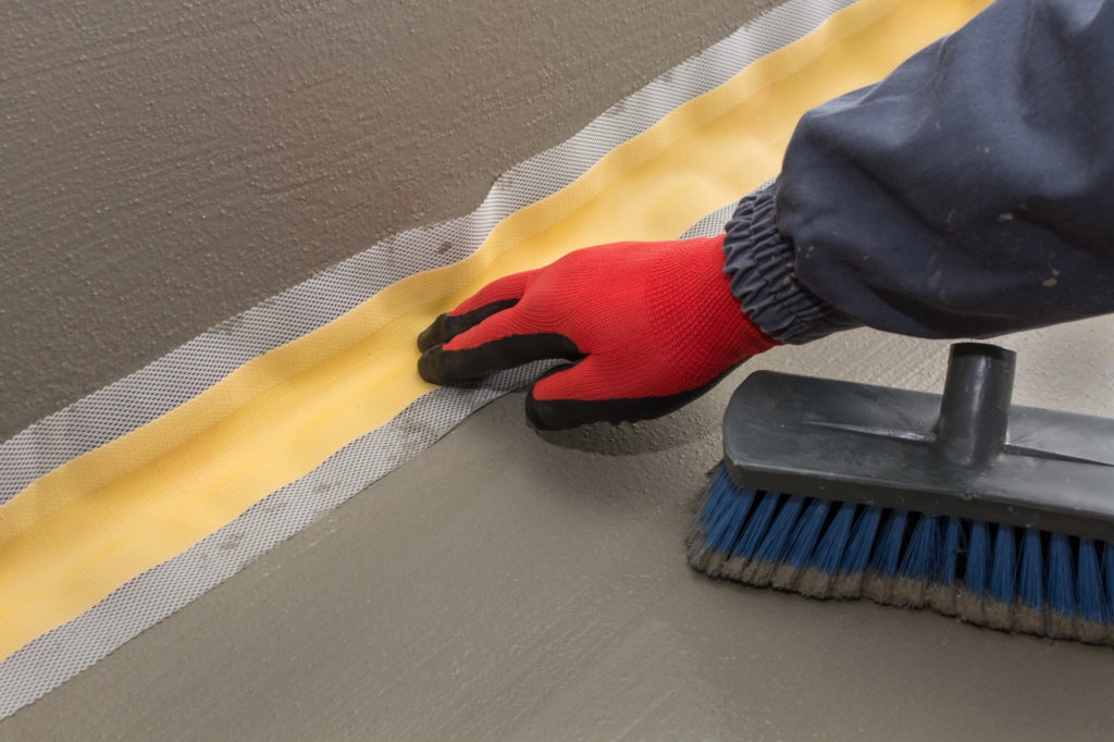 the proper placement of sealing tape, waterproofing tape in the first layer of waterproofing